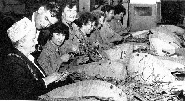 In the past women have done a variety of jobs: from working in factories during war periods to steamming tobacco leaves. In this picture Florence Brown, the first female Lord Major of Bristol, returns to her old job in a factory for a few minutes (June 1963).