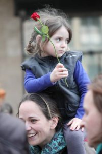 A little girl with her mother is taking part in the demonstration for obstetric rights in Hungary